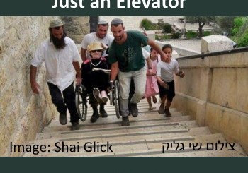 carrying disabled person in wheelchair up stairs leading to entrance to the cave of the patriarchs