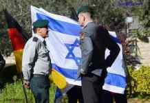 Israeli and German military officers talking