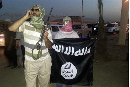 ISIS in Iraq with flag (file)
