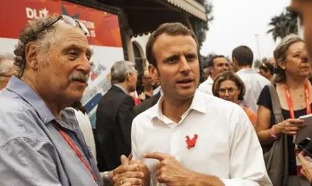 French Economy Minister Emmanuel Macron (R)
