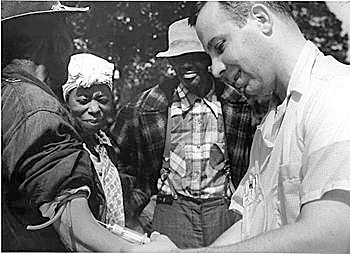 Tuskegee Syphilis Study Doctor Injecting A Negro Subject