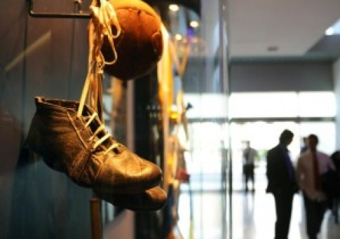 Football boots are on display in the hal