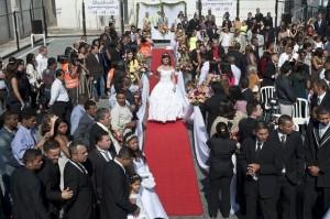 A bride walks down the aisle during a ma