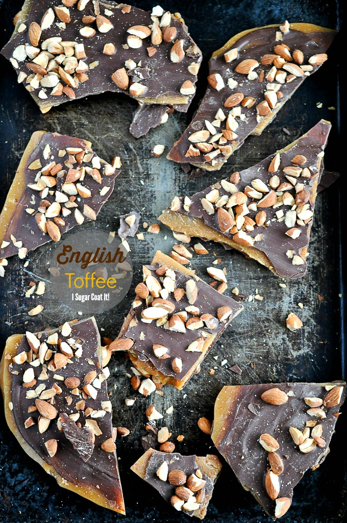 Almond English Toffee with homemade toffee sandwiched between thin layers of decadent dark chocolate and topped with roasted almonds.