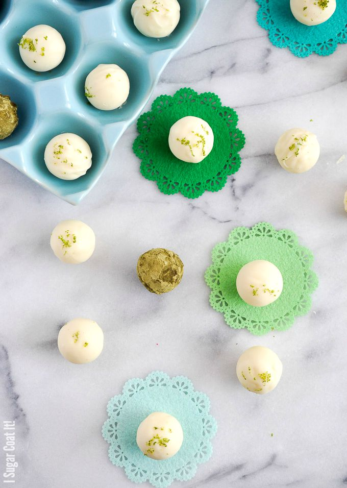 White Chocolate Mojito Truffles are delicate white chocolate shells filled with a luxuriously smooth ganache with fresh lime, mint and a touch of vodka.