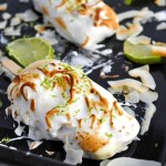 Creamy, tart and sweet Key Lime Curd Meringue Popsicles clad in lightly toasted meringue - basically, a pie on a stick!
