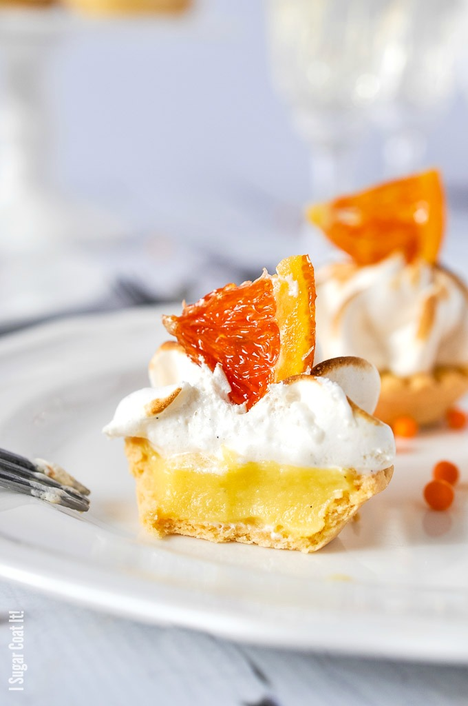 Candied Cara Cara Curd Meringue Tarts are mini bites of sweet, tangy, creamy sunshine topped with clouds of vanilla bean meringue and candied oranges.