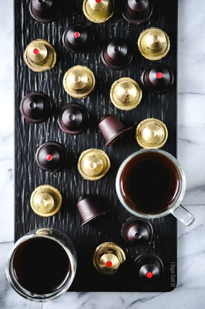 A coffee lover's dream, these Caramelized Cacao Nibs Bonbons are dark chocolate nespresso-like pods are filled with a luxurious white chocolate espresso caramelized cacao nib ganache.