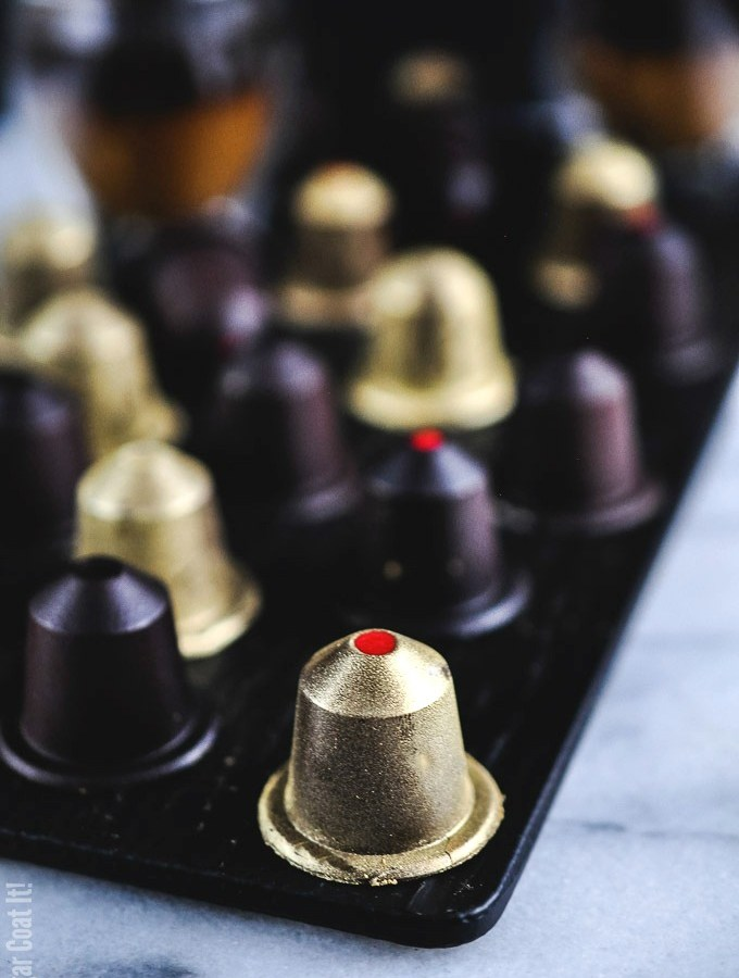 A coffee lover's dream, these dark chocolate nespresso-like pods are filled with a luxurious white chocolate espresso caramelized cacao nib ganache.
