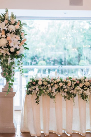 Beautiful flower arrange for head table - Beautiful simple + elegant outdoor wedding under the Chateau in the garden | itakeyou.co.uk - garden wedding ,outdoor wedding ,blush wedding