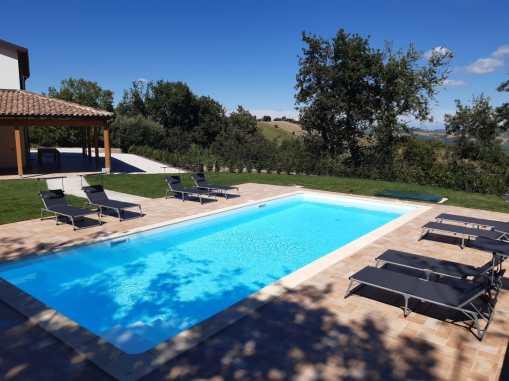 Zwembad en aan links huis Sole