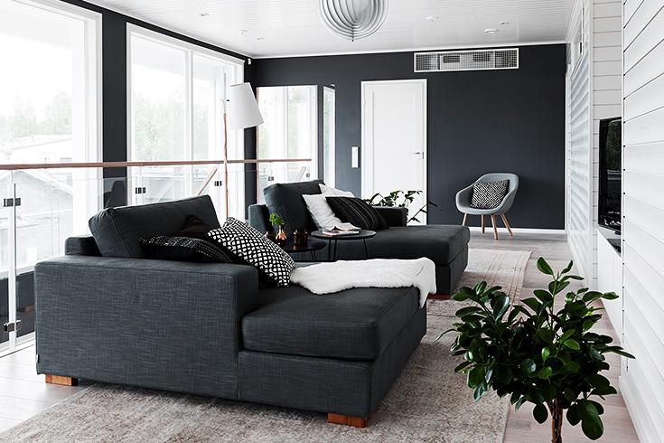 finnish home interior, finland home decor, wall gallery, black wall decor, gallery wall idea, dark grey corner couch, divno angolare grigio scuro