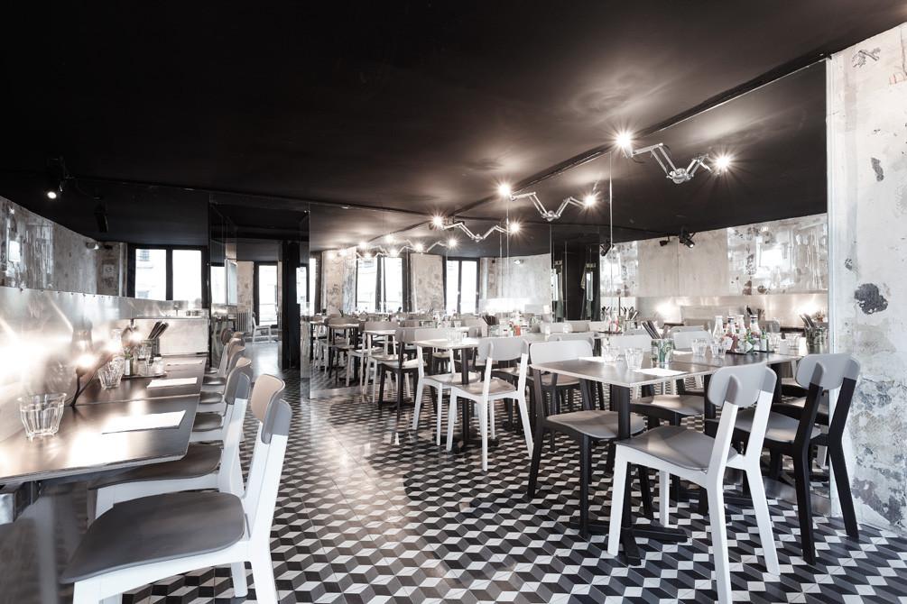 Black ceiling interior design in paris new york restaurant