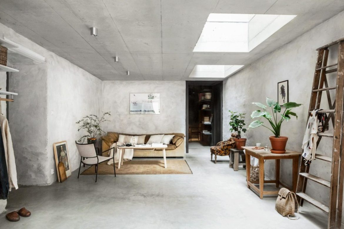 concrete walls interior trends, raw cement walls, scandinavian style interiors, decorate with concrete walls, velvet sofa, ochre yellow sofa