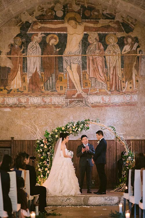 romantic wedding ceremony inside La Badia
