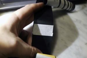 Il nastro adesivo per l'aggancio della testa della pellicola