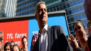 WCENTER 0SQFAGMKLN                Sadiq Khan, Labour's Candidate for Mayor of London, speaks in front of Labour's four campaign adverts at Montgomery Square in Canary Wharf, London. PRESS ASSOCIATION Photo. Picture date: Wednesday May 4, 2016. See PA story POLITICS Mayor. Photo credit should read: Stefan Rousseau/PA Wire LaPresse Only italy Sadiq Khan, candidato laburista a sindaco di Londra