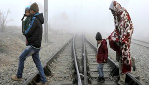 Migrants cross the railway tracks as they wait to cross the Greek-Macedonian border near the village of Idomeni, Greece, January 28, 2016. REUTERS/Alexandros Avramidis GREECE OUT. NO COMMERCIAL OR EDITORIAL SALES IN GREECE