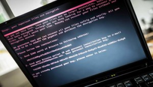 epaselect epa06053537 A laptop screen displays a message after it was infected with ransomware during a worldwide cyberattack, in Geldrop, Netherlands, 27 June 2017 (issued 28 June 2017). Kaspersky Lab reported that the malware, despite resembling 'Petya' malware that affected computers last year, is believed to be a new type of ransomware, which the cybersecurity company called 'ExPetr'. The ransomware has reportedly affected mostly Ukraine and Russia and several cases were also found in Poland, Italy, Britain, Germany, France, the US and several other countries, with around 2,000 cases reported so far. The ransomware has reportedly affected US pharmaceutical giant Merck, Russia's oil producer Rosneft, Ukrainian central bank, Spanish food company Mondelez, who owns Cadbury chocolate factory and French shipping company TNT, among other global companies. EPA/ROB ENGELAAR