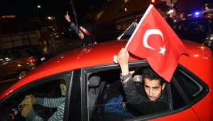 Turkish nationals, supporters of president Recep Tayyip Erdogan, currently residing in Bosnia and Herzegovina, cheer in downtown Sarajevo, late on June 24, 2018. - After 15 years in office that have already transformed his country, President Recep Tayyip Erdogan is set to return to power aiming to establish himself alongside founder Mustafa Kemal Ataturk as the leading figures of modern Turkish history. (Photo by STR / AFP) (Photo credit should read STR/AFP/Getty Images)