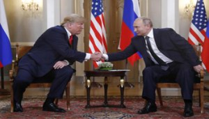 U.S. President Donald Trump, left, and Russian President Vladimir Putin shake hand at the beginning of a meeting at the Presidential Palace in Helsinki, Finland, Monday, July 16, 2018. (ANSA/AP Photo/Pablo Martinez Monsivais) [CopyrightNotice: Copyright 2018 The Associated Press. All rights reserved]