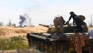 epa04670040 A Libyan militia in command of a tank clashes with rivals near Bir al-Ghanam, 90 km north of Tripoli, Libya, 19 march 2015. According to local reports one member of a militia blew himself up in clashes which claimed the lives of nine and left 14 wounded from both sides, as fighting continues in the war torn country, in which a senior commander from a group which has pledged allegiance to the group calling themselves the Islamic State (IS), Tunisian Ahmed Rouissi, was killed 17 March, and as the situation in Libya is expected to be discussed at an EU Heads of government meeting taking place in Brussels. EPA/STR