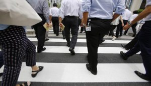 Office workers walk on a pedestrian crossing during a lunch break in Tokyo Monday, June 8, 2015. Japan's economy grew at a faster pace than initially estimated in the January-March quarter on stronger consumer and corporate spending, though economists anticipate slower growth in April-June. The 3.9 percent annualized growth rate announced Monday by the Cabinet Office was sharply higher than the 2.4 percent pace initially reported. (ANSA/AP Photo/Shizuo Kambayashi)