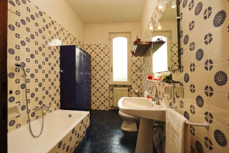 Bathroom 1 with a bathtub
