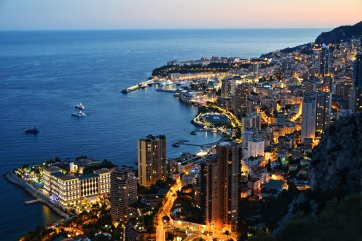 View of the city of Monaco by night. French Riviera