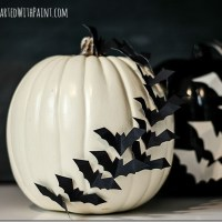 Bats Flying Across A Pumpkin