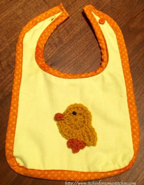 Fabric Bib with Crochet Appliqué. http://www.itchinforsomestitchin.com
