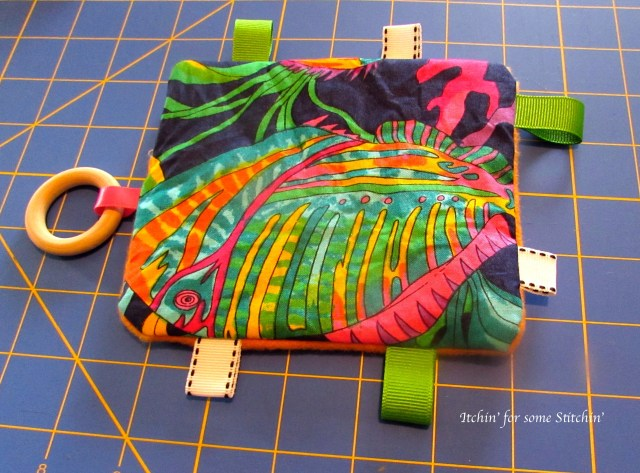 Front of completed taggie toy. http://www.itchinforsomestitchin.com