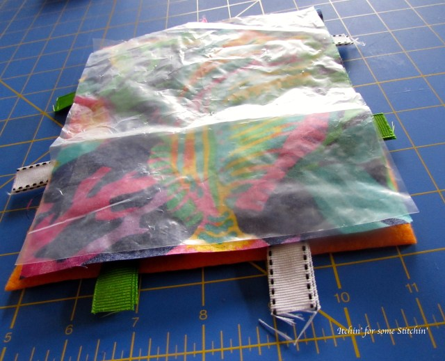 Layering the taggie toy. http://www.itchinforsomestitchin.com