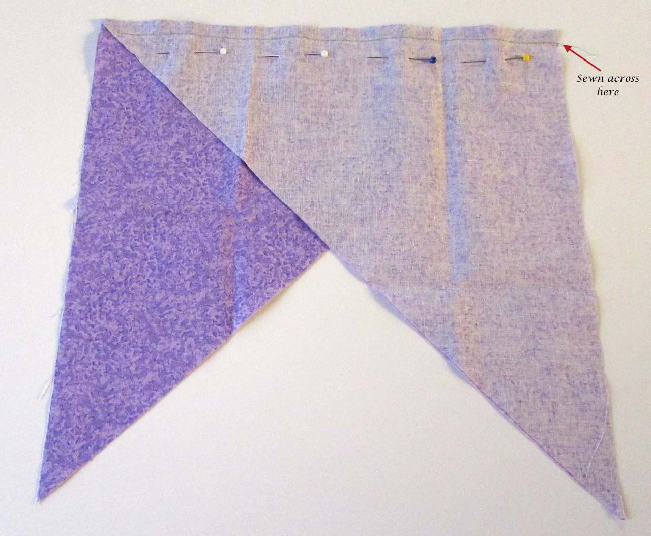 Triangles pinned and sewn together for continuous bias binding tape by www.itchinforsomestitchin.com