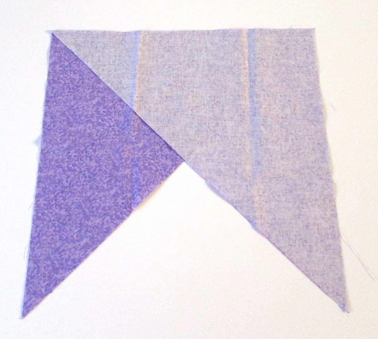 Triangles put together for bias binding by www.itchinforsomestitchin.com