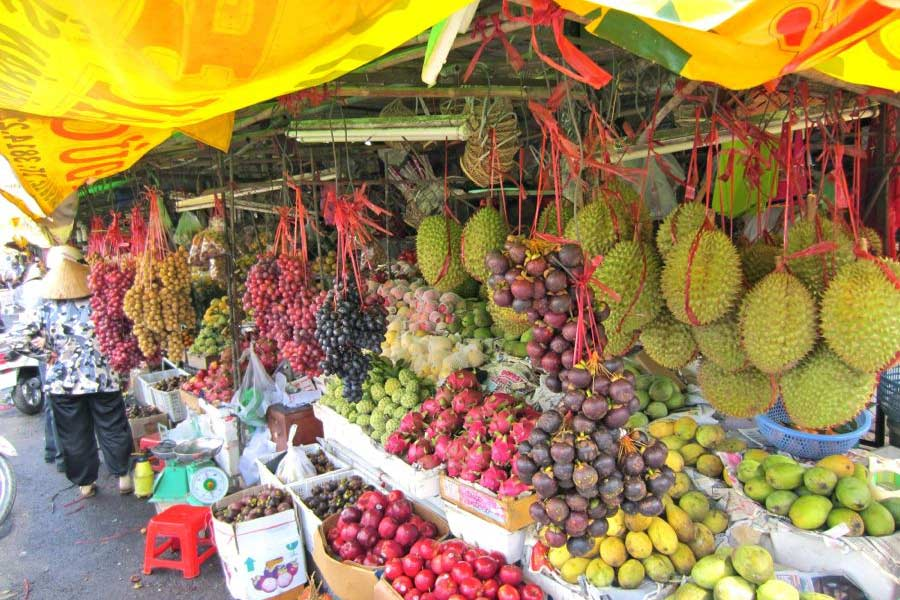 durian, longan, and more fruit for sale at ben tre market in vietnam