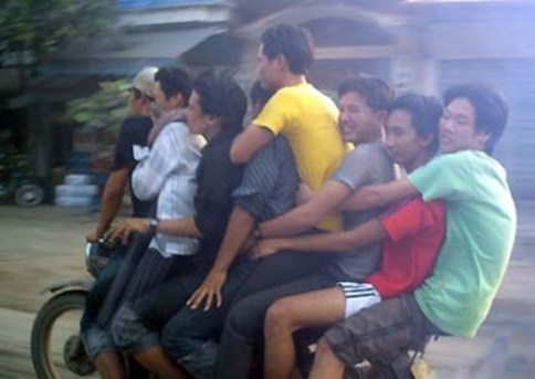 8 People riding on one motorbike in Vietnam