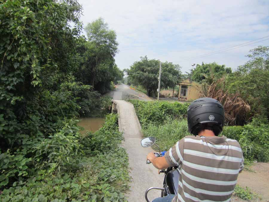 Motorbike riding through the county-side in Vietnam