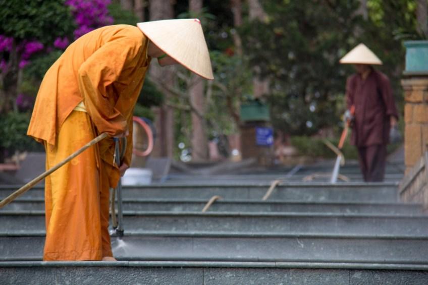 Dalat, Vietnam - monks cleaning stairs