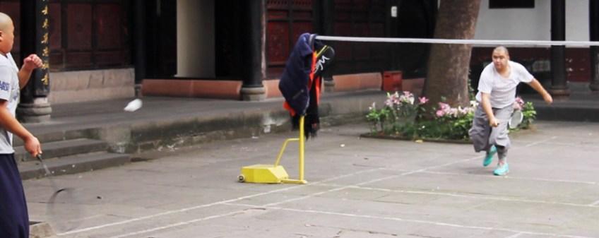 monks playing badminton in wenshu monastery