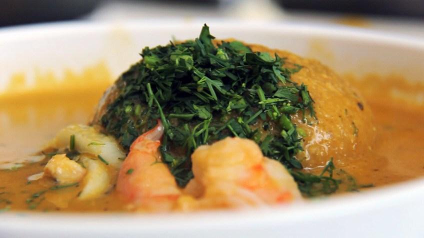 caldo de bolos de verde - a seafood soup with a ball of green banana