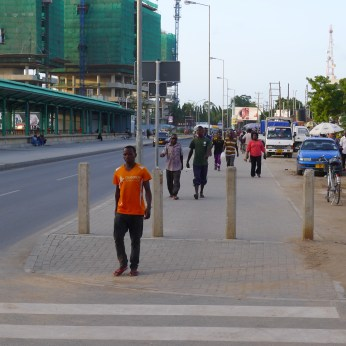 New pedestrian spaces along the corridor transform the streetscape.