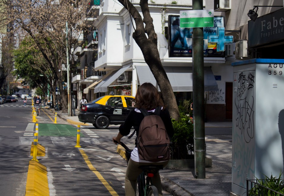 A cyclist takes advantage of new protected bike infrastructure (Ciudad de Buenos Aires, Wikimedia Commons)