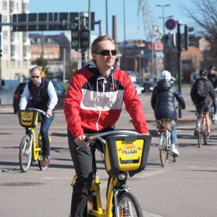 The capital and largest city in Finland is already bike-friendly, with over 1200 km of dedicated bike lanes, and is close to reaching their official goal of 15% of all transit served by cycling by 2020. Like many cities that have successfully integrated bikeshare, Helsinki treats it like public transit, with an integrated fare card and easy connections to transit. Recently, the city announced that they would integrate cycling into the MAAS (Mobility as a Service) platform that connects public transit with student and disability transportation services and provate sector offerings, including shared-resource services. Photo Credit: Martti Tulenheimo, Flickr