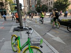 While Seattle enjoys a reputation as an environmentally and bike-friendly city, it has struggled to integrate bikeshare into their transit network. In 2017, the city shut down its seldom-used bikeshare system, Pronto, after several attempts at expansion hit political roadblocks. Some cycling advocates pointed to the city's mandatory helmet law, and the lack of a quality, protected cycle network in a downtown area heavily congested with cars as reasons for Pronto's demise. Today, Seattle has fully embraced dockless bikeshare as the first city to introduce comprehensive permit requirements before operators launched. The city is becoming a best practice example for dedicating city resources to managing and enforcing dockless permit requirements, and is currently piloting dockless bikeshare parking zones.