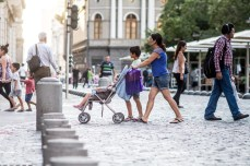 Woman pushing stroller