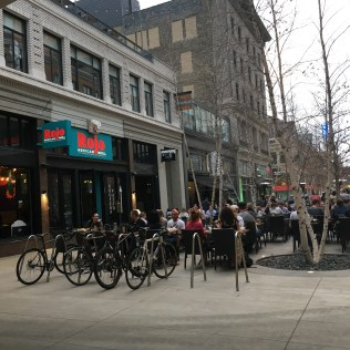 Bicycle rack in front of outdoor dining area in Downtown Minneapolis