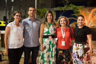 4 women and one man smile at an outdoor reception in Fortaleza, Brazil