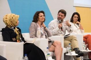 Riri Asnita, Laetitia Dablanc, Claudio Orrego, and Ana Toni on MOBILIZE stage during climate change plenary