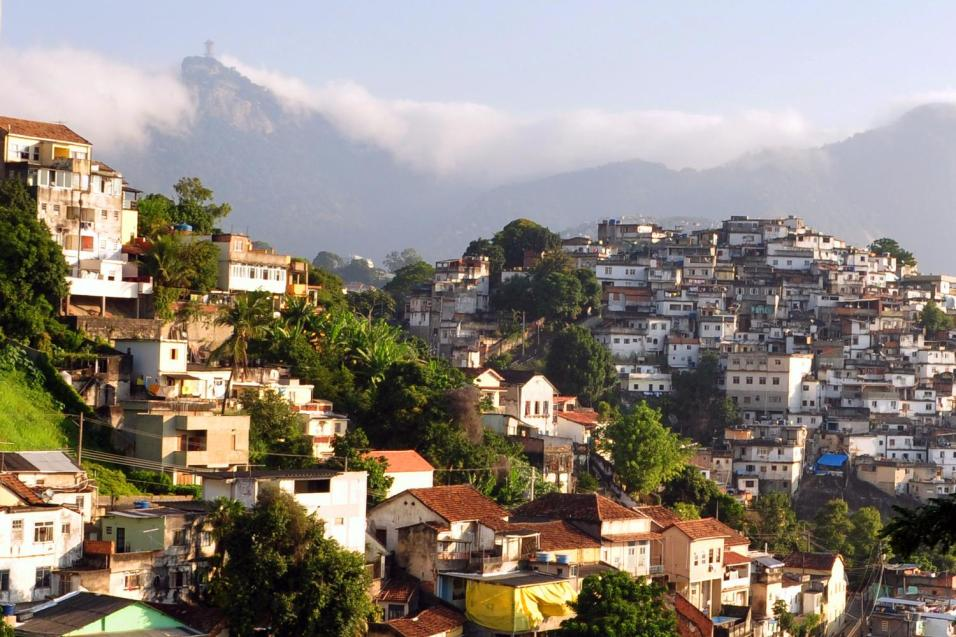 Favelas are densely populated informal housing found throughout Brazil, here shown behind a wealthier hillside neighborhood.